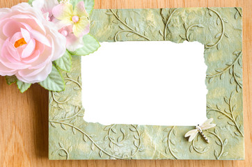 Blank phot frame and pink rose flower