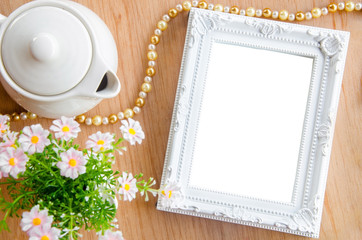 Blank photo frame and flower.