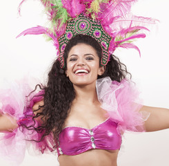 Gorgeous samba dancer wearing traditional pink costume