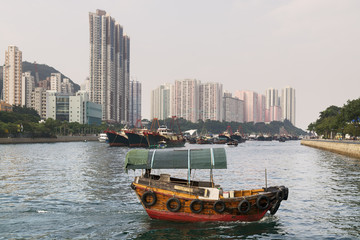 Aberdeen Harbour, Hong Kong with a passing sampan boat.