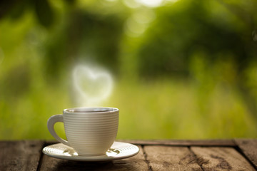 coffee cup on green background