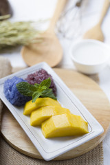 Thai style tropical dessert, sticky rice served with mango