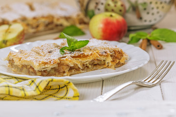Tart of puff pastry with apples, close up