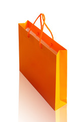 Orange recycle paper shopping bag on white clipping path.