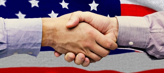 Composite image of hand shake in front of wires