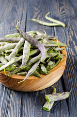 Green fresh soybeans on wood background
