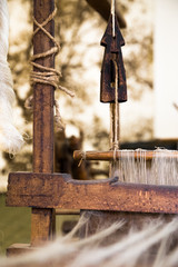 Closeup image of an old weaving Loom