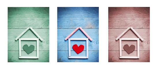 chalk house with heart shape inside on wooden background, triptych in green, blue and brown