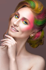 Fashion Girl with colored face and hair painted. Art beauty