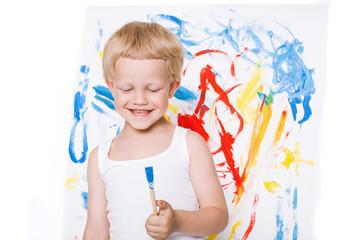 Cute little boy painting with brush. School. Preschool. Education. Creativity