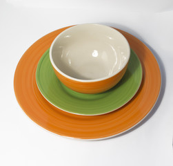 Ceramic plates and bowl with spiral pattern