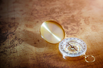 Retro compass on ancient world map, vintage style