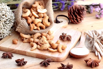 Roasted cashews nuts with natural on wood background