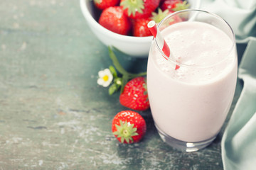 A glass of strawberry smoothie