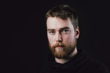 Portrait of a handsome young man. Studio shot.