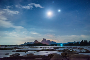 beautiful night view of mountain landscape in lake with star in