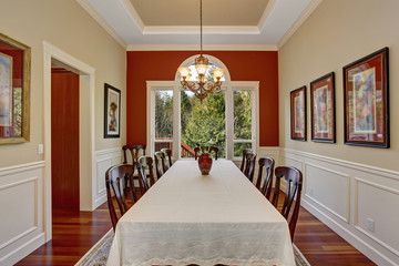 Dinning room with large table and lots of chairs.