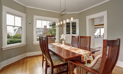 Traditional dinning room with hardwood floor, and hanging light