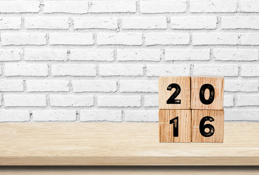Wooden cubes with 2016 on wooden table background