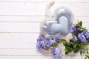 Background with  blue  flowers and  decorative heart
