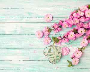 Tender pink flowers and decorative heart