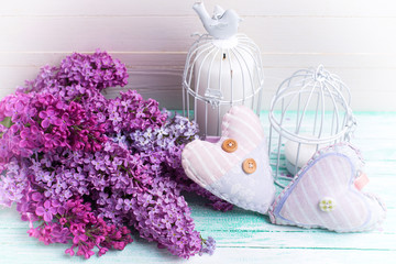 Background  with fresh lilac flowers, decorative hearts and cand