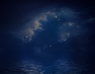 Space background with nebula and stars reflected in water surface.