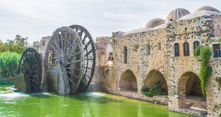 Noria of Hama, water wheel along the Orontes River in the city of Hama, Syria.