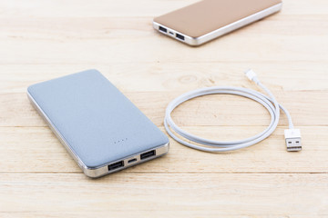 Power bank and USB cable for smartphone.