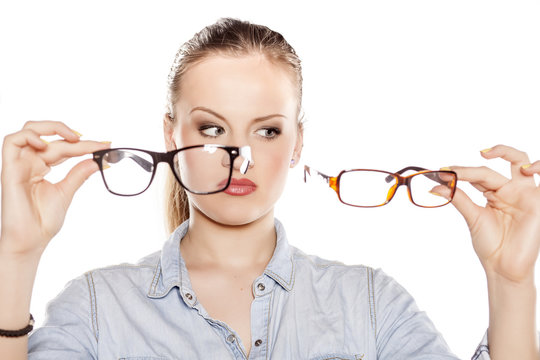 serious young blonde compares glasses