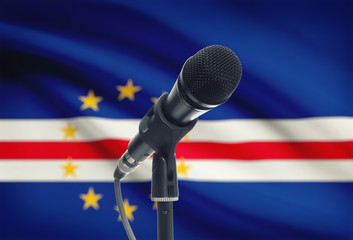 Microphone on stand with national flag on background - Cape Verde