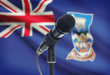 Microphone on stand with national flag on background - Falkland Islands