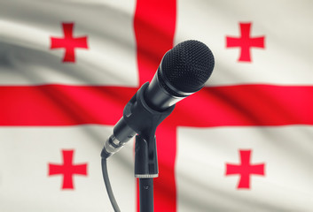 Microphone on stand with national flag on background - Georgia