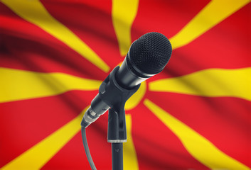 Microphone on stand with national flag on background - Macedonia
