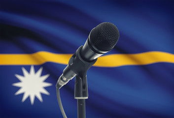 Microphone on stand with national flag on background - Nauru