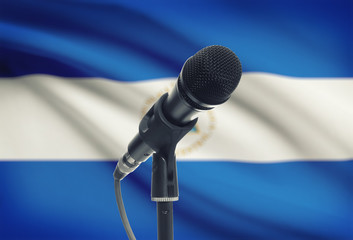 Microphone on stand with national flag on background - Nicaragua