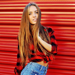 Fashion style portrait of a beautiful young woman outdoor