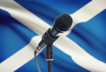 Microphone on stand with national flag on background - Scotland