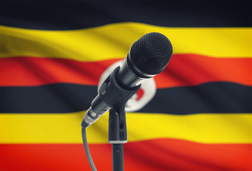 Microphone on stand with national flag on background - Uganda