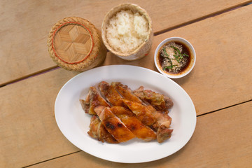 Grilled chicken and rice with sauce in dish