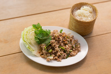 Thai Spicy minced meat salad with sticky rice