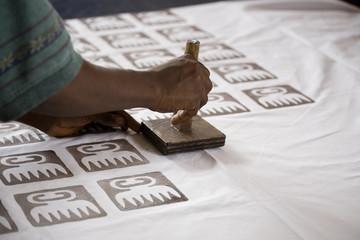 Man Stamping Batik
