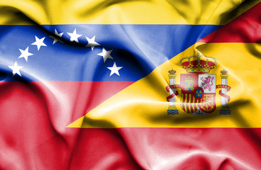 Waving flag of Spain and Venezuela