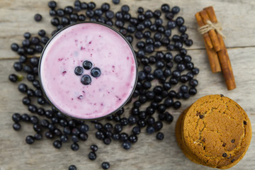 Blueberry smoothie with berries on wooden background. Healthy vegetarian food, diet.