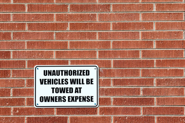 Sign warning of the consequences of parking here