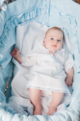 Cute baby boy laying in cradle