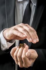 Businessman nurturing a butterfly
