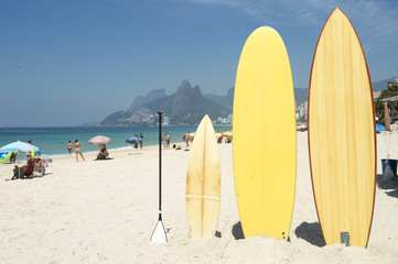 Surfboards and stand up paddle boards line up on the beach at Arpoador, Ipanema, Rio de Janeiro Brazil