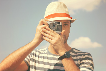 Man with the old camera – retro stile
