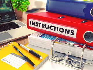 Instructions on Red Office Folder. Toned Image.